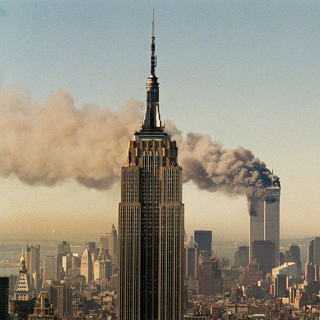 best ci twin towers world trade center images 2001 file photo the twin towers of the world trade center burn behind the empire state building in new york
