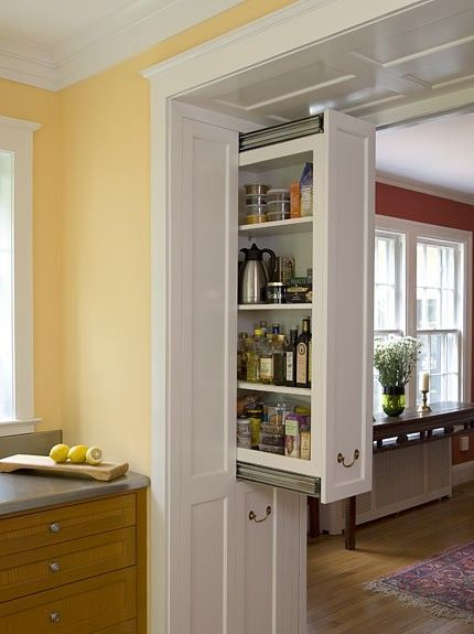 Cabinets built in to the door casing. Great idea to maximize storage space