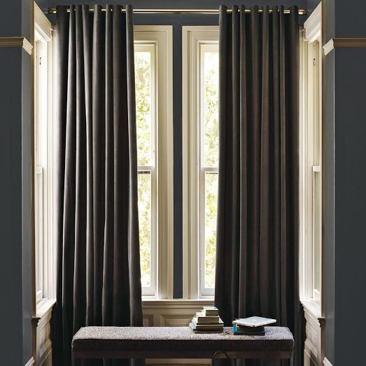 A smoky grey palette with deep charcoal velvet curtains.