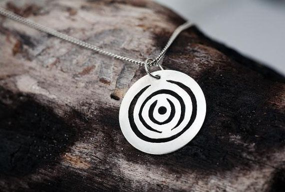 Circular swirly silver pendant by StudioAg47 on Etsy, $28.00