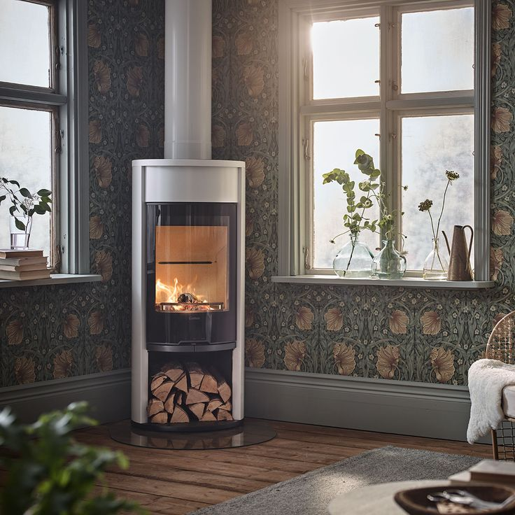 Contura 610G Style in white with glass door and log compartment. Choose from powerstone, lower door, fan or a hotplate.#whitestove #contemporarystove #hardwoodfloor #wallpaper #skirtingboard #chimney #contura600 #conturastyle