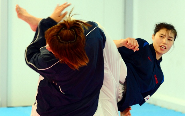 Team Korea Olympic training camp at Brunel University in July 2012 - London 2012 taekwondo gold medalist Hwang Kyung-Seon (right) in training. Google Image Result for http://static.news.zum.com/images/1/2012/07/22/l_2012072201007290400223601.jpg