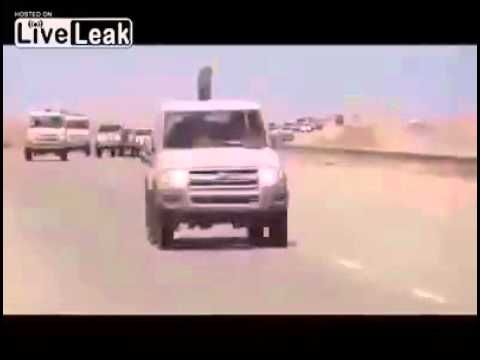 United States Apache attack helicopter following behind ISIS convoy into...