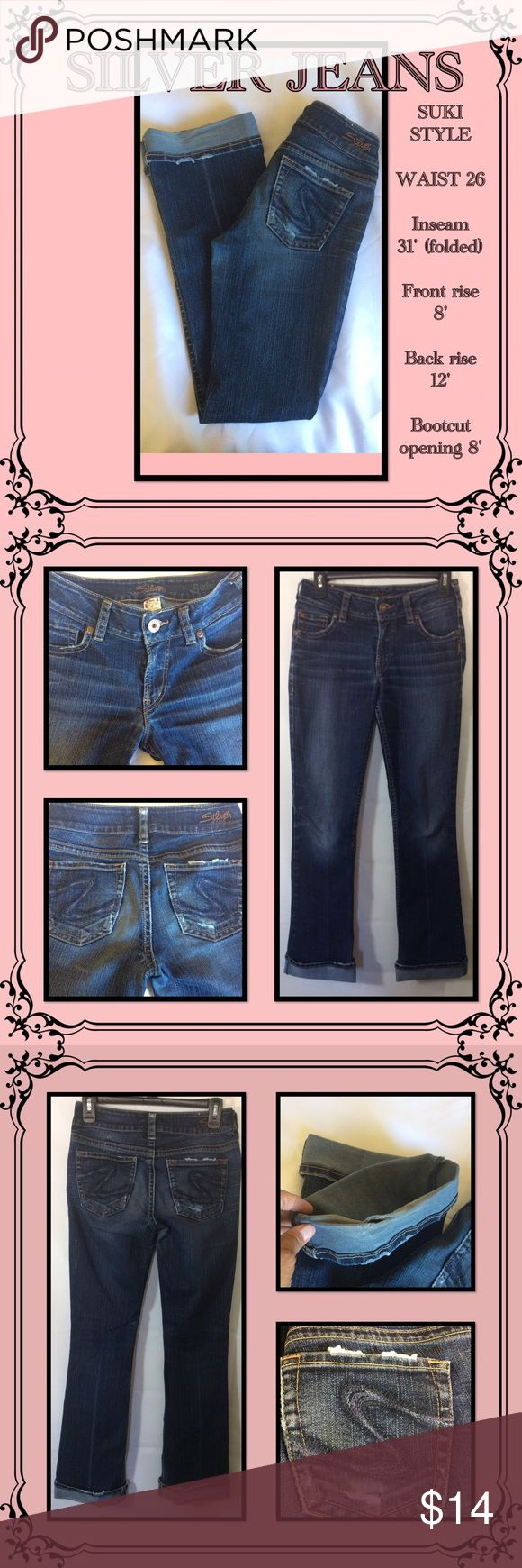 """Silver Suky Style Jeans Pre loved jeans// yellow/copper stitching// dark blue, black and navy stitching on the pockets """"S"""" // distressed style // the only rip is in the folded hem, please see picture // zip fly// Silver Jeans Jeans Boot Cut"""