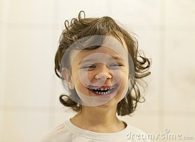 Child laughing that has a cranberry mustache