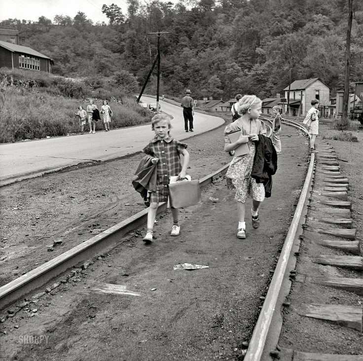 """September 1938. Osage, West Virginia. """"Mining town. Coming home from school."""" Medium format nitrate negative by Marion Post Wolcott."""