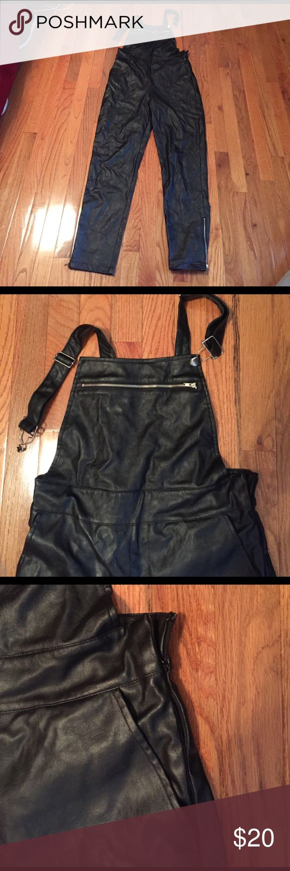 Black Leather Overalls Black Faux leather overalls from nasty gal. Great outfit maker. Size medium, no stretch. Straight leg with zipper detail. Side zipper closure. Side zipper is broken and needs to be replaced. Top right button of Overalls is also missing and needs to be re- attached. (Button is included in pocket, just need to be re- attached). Only worn once, Overalls are in great condition besides the 2 missing pieces. Nasty Gal Other