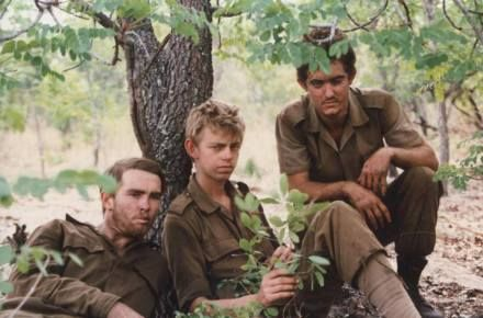 """Members of the SADF's 61 Mech Batn take a rest during the fighting on the Lomba riv Angola 1987. Having just written a High School matric - barely 18 or 19 years old – have just shattered the Angolan/Cuban coalition's mech offensive. Fighting in Ratel Infantry vehicles against Russian T 55 Tanks The """"thousand yard stare"""" brought about from fatigue and extensive exposure to combat, ageing them well beyond their years. Thank you to the 61 Mechanised Battalion veteran fraternity for the image."""