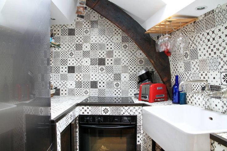 Charming Black and White Tiles in a Parisian Kitchen