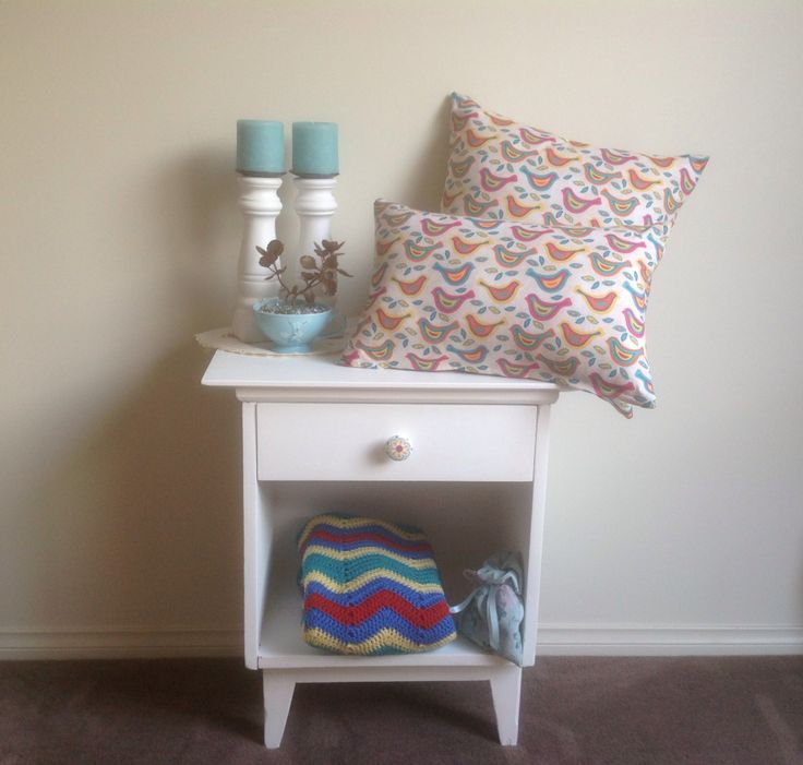 Pre-loved side table with aqua accessories. Cupboard and cushions SOLD.
