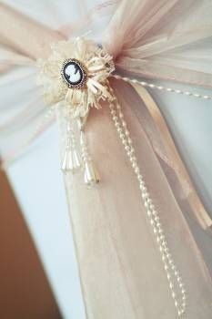 Loving this cameo rosette for my wedding chairs to run with my victorian cameo and birdcage themed wedding xx