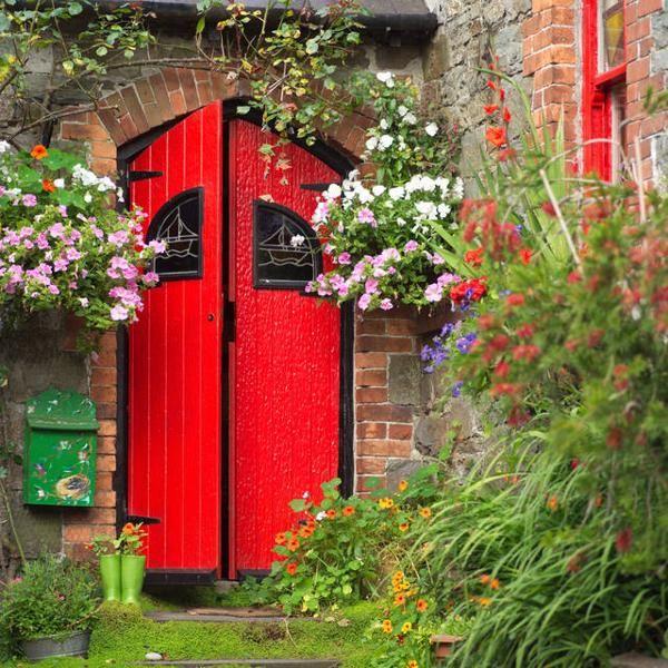 feng shui home design with red exterior door
