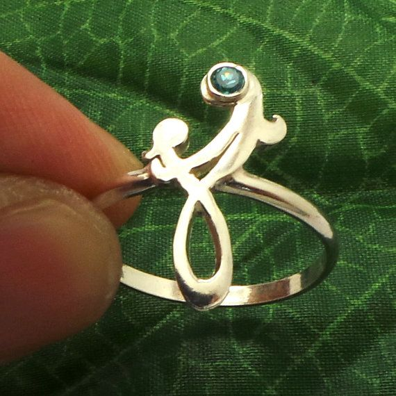 Mother Infinity Knot Ring with birthstone. A tattoo-inspired ring