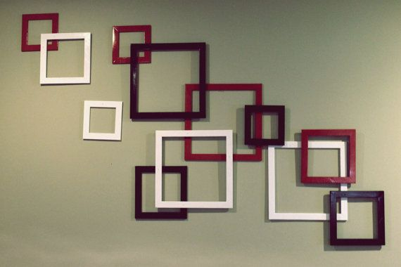 Cool idea, spray paint goodwill, rummage sale or dollar store frames red, black and white (or gray) and glue them together....