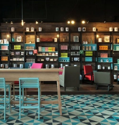 Neon colors and triangular geometric floor makes this retail interior stand out