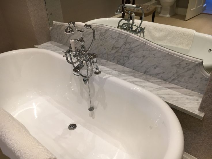 Bath marble shelf and marble splashback against mirror all in Honed Carrara