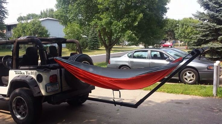Jeep hammock. SOOOO investing for camping trips