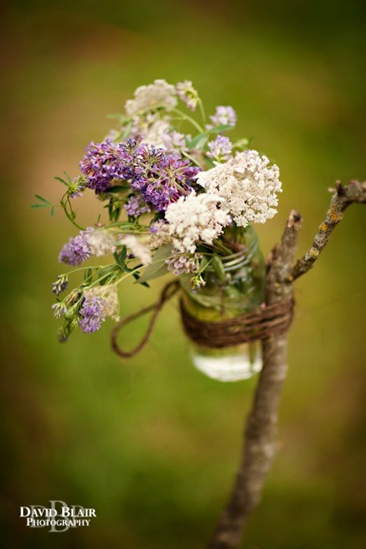 Jam jar flowers on branches