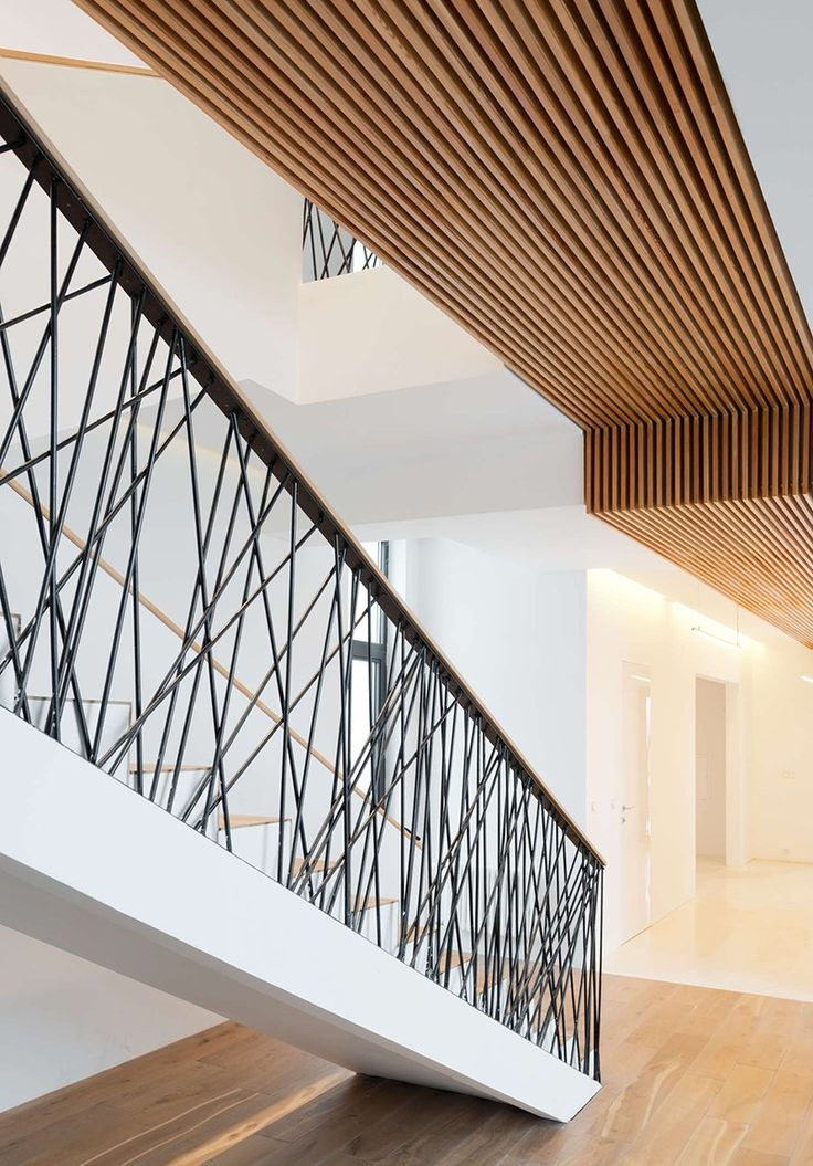DESIGN DETAIL – Random Railings - This home designed by Monoloko Design, features custom railings on the stairs and the top floor, made from randomly placed steel supports that have been powder coated black.