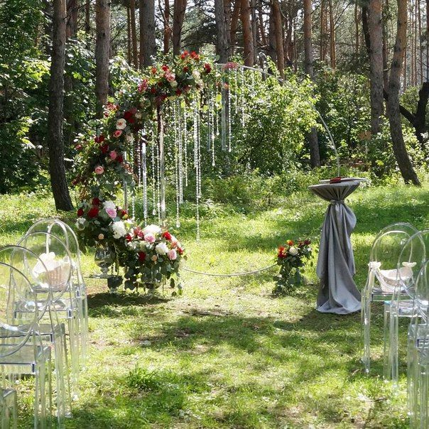 Modern circular ceremony arch with hanging crystals