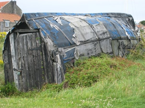 Holy Island - an upside down, old boat made into a shed along the water.