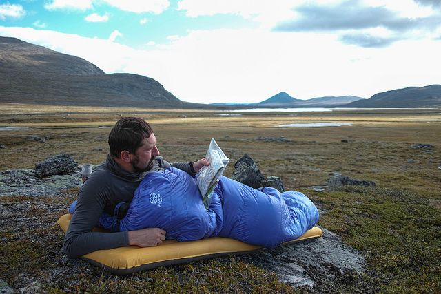 Reading the map in a Cumulus sleeping bag and Thermarest mattress on our trip in Sarek National Park  More on our blog: http://hikeventures.com/hiking-and-packrafting-in-sarek-day-1/