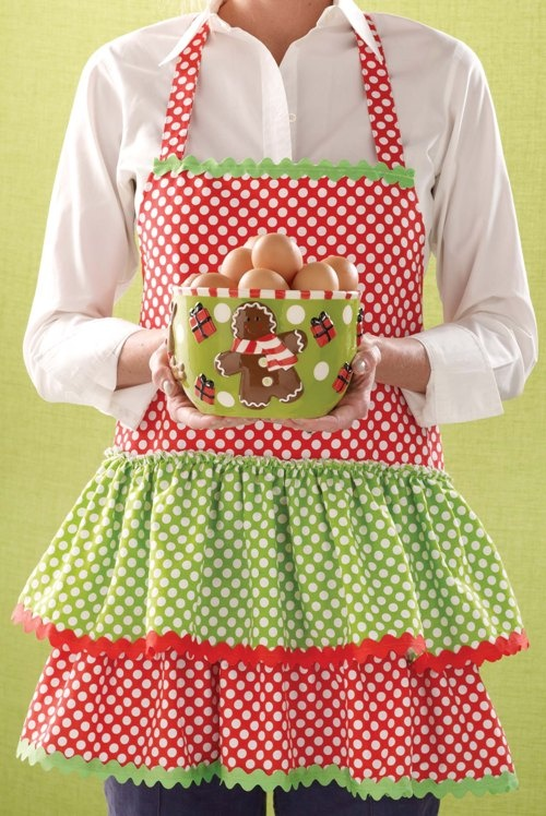 Fun Christmas aprons: at least 6-8 full aprons of different colors and designs, at least 6 half-aprons, also different.