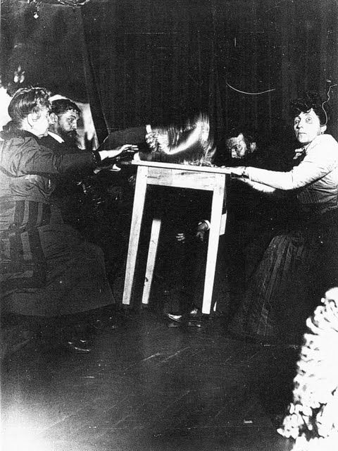 """Seance with Eusapia Palladino at the home of Camille Flammarion, Rue Cassini. Full levitation of a table."" 12 November 1898, Gelatin silver print."