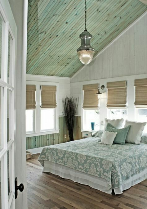 Beautiful Beach Cottage Bedroom with Washed Out Wood Celings And Paneling