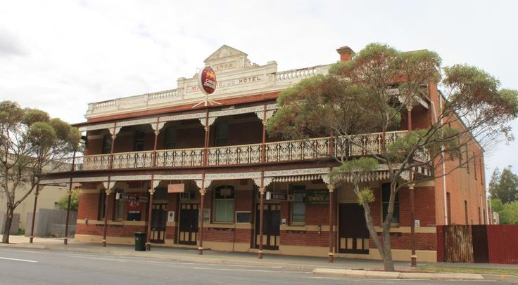 The Club Hotel at 95 Main Street in Minyip. In 1877 Thomas Byrne Carroll purchased Allotment 7 Section 3 of the Minyip Township, and built a hotel in 1890. Catherine Keenan completed the 2-storey brick building in 1907, it had 40 rooms (including 23 bedrooms). In 1929 a fire which gutted 5 wooden shops badly gutted the west side of the hotel. In the 1980s the hotel featured in the 'Flying Doctors' tv series.