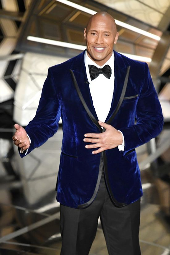"Dwayne Johnson in a Robert Mata blue velvet suit at the 2017 Oscars: ""Thank you God for the Rock. Because the world needs a gigantic, beautiful man who can pull off a midnight blue velvet dinner jacket."" Tom & Lorenzo"