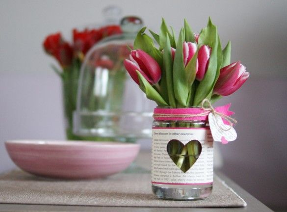 floral arrangement in simple jar that's dressed to give to someone