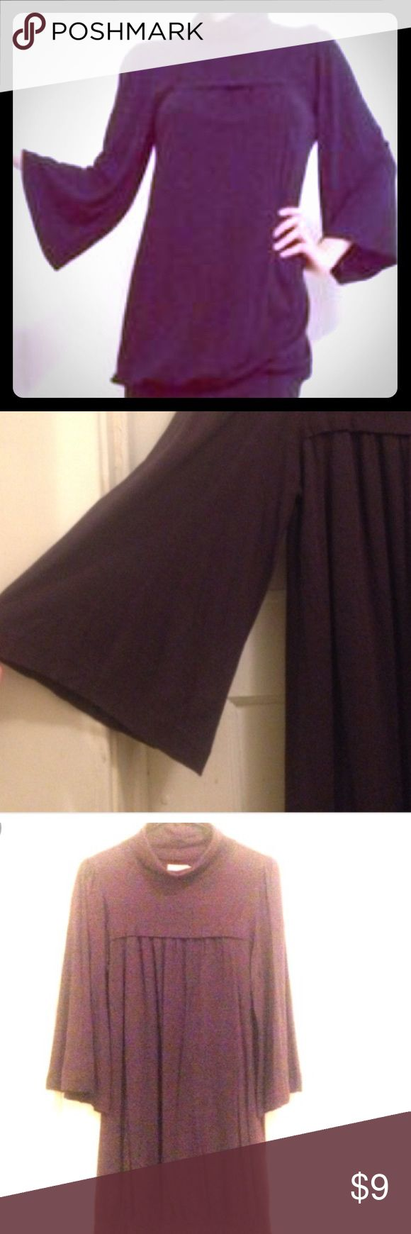 Juicy purple turtleneck tunic Size M. Juicy Couture Turtleneck Tunic w/ wide sleeves in a Gorgeous Deep Shade of Purple. Material is soft like a T-shirt. So comfy and light! Juicy Couture Dresses Mini