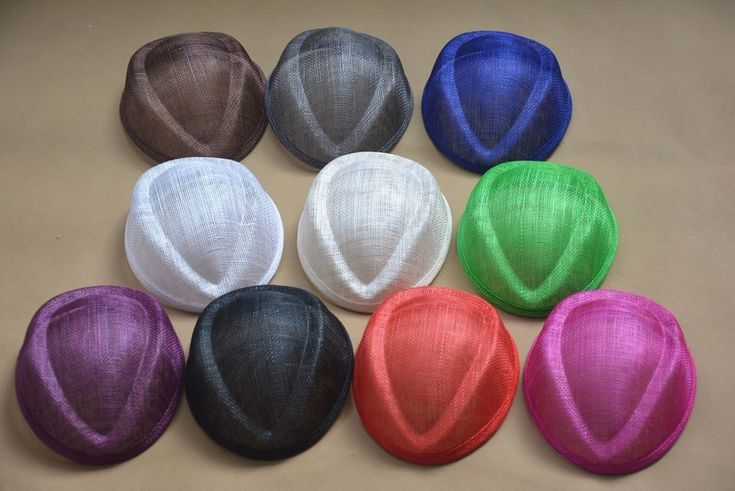This Air Hostess pillbox hat base is made from woven sinamay abaca and is an ideal size for making fascinators. Each base is edge with sinamay ribbon and is ready for you to decorate! Each top hat is roughly 17cm long, and 14cm wide at the longest points.   eBay!