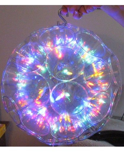 """Sparkle Ball - How to - You'll need 50 soft 9 oz. tumbler-style plastic cups, a hole-puncher, a drill with a 1/2"""" bit, a string of mini-lights (100-150), and 200 small zip-ties. (recycled clean cups will work perfectly as will an old string of mini-lights.)"""