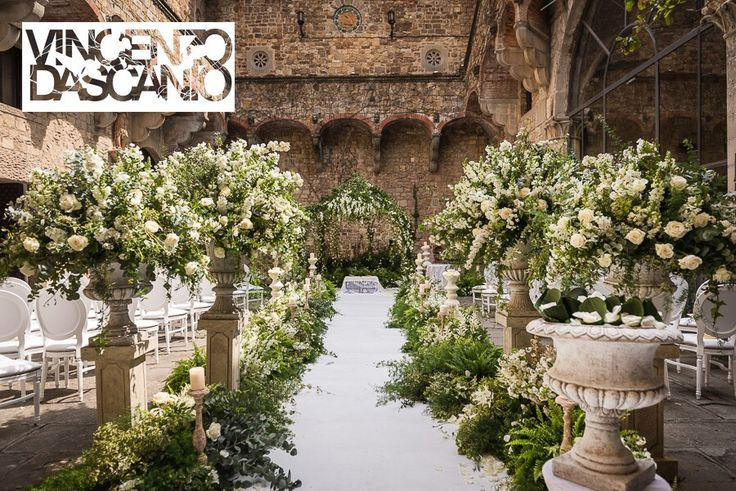 Bucolic organic aisle, greenery and white flowers compositions in medici vases