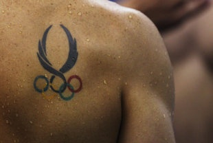 Olympic Tattoo...i want one one these bc to means the coming to together of all different kinds of people and i like diversity so yeah!