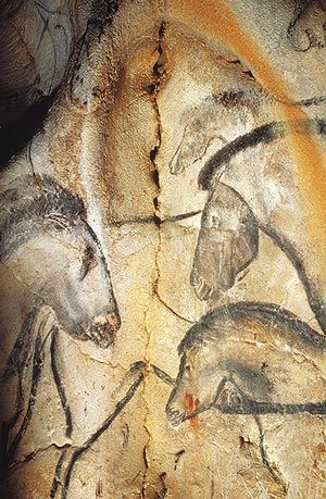 "Horse heads on the wall of Chauvet Cave, France - photo by some.maniac, via Flickr;  ""Fourteen different animal species are depicted in the Chauvet Cave. Here, three beautiful horses' heads face one another.""  - MetMuseum"