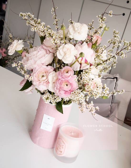 Pink peony arrangement. Pretty pink vase is covered with cotton fabric