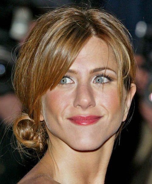 Jennifer Aniston Hairstyles - The Stylish and Elegant Low-do with Bun and Messy Bangs