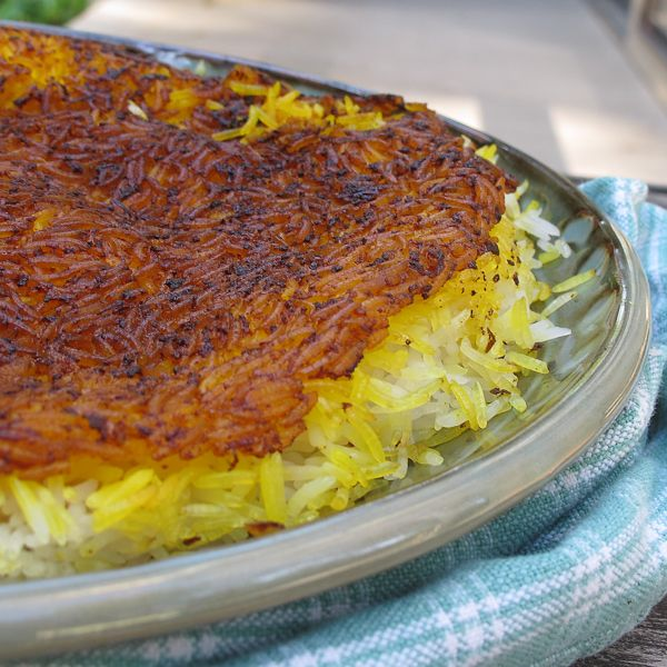 Crispy Persian Rice (Polo Tahdig)OMG.... I love this rice!  I only get it when I'm @ my friend Naemeh's house. Now I can try & make it ;)