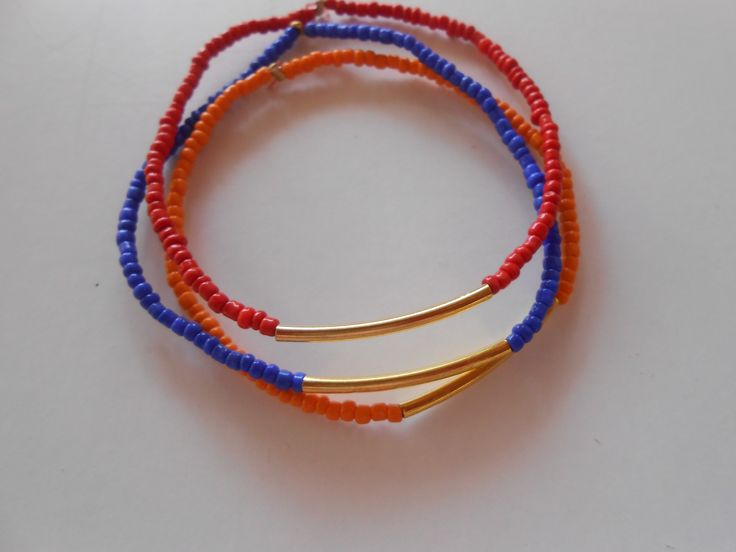 A set of three Beaded Elastic Bracelets with Golden Spacers. It would go perfectly with Macrame Bracelets. www.highmoda.eu