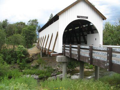 Wimer, Oregon covered bridge was built in 1892 . I lived within 2 miles of this bridge. It is a fully operable bridge to single lane traffic and foot traffic. Locals are very proud of the bridge and have had to rebuild it twice due to flooding since the late 1800's. At one time there were over 400 covered bridges in Oregon. There are now less than 50.