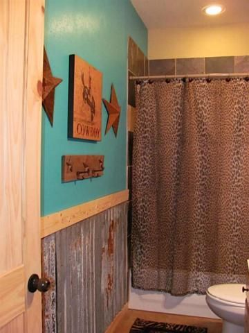 Sassy cowgirl kitchen that is dressed up with turquoise paint and a cheetah shower curtain. | Stylish Western Home Decorating