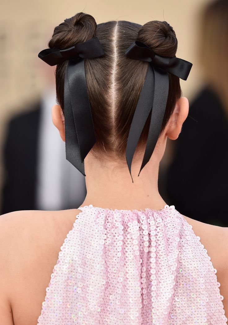 Millie Bobby Brown Brought Your Favorite Early 2000s Hairstyle to the Red Carpet | Millie Bobby Brown brought one your favorite early 2000s hairstyles to the 2018 SAG Awards red carpet. The 'Stranger Things' star wore two space buns wrapped with black ribbon. See the actress' hairstyle here.
