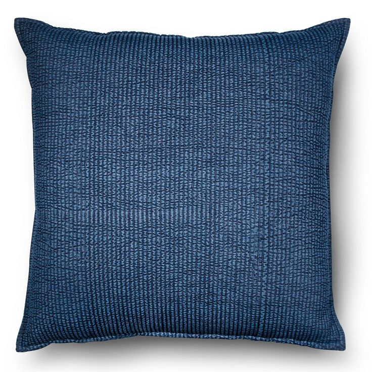 "A twist on the traditional denim styling, the Threshold Oversized Throw Pillow in Chambray Denim Blue will add interest to your décor. The accent pillow is covered in a 100% cotton denim fabric that is given a quilt stitching in tight rows for a rumpled texture. The decorative pillow measures a large 24"" square."