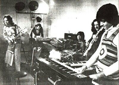 Goblin Band. Members :Walter Martino (percussion), Massimo Morante (guitars), Fabio Pignatelli (bass) and Claudio Simonetti (piano). Probably most famous for their work on Dario Argento's movies.