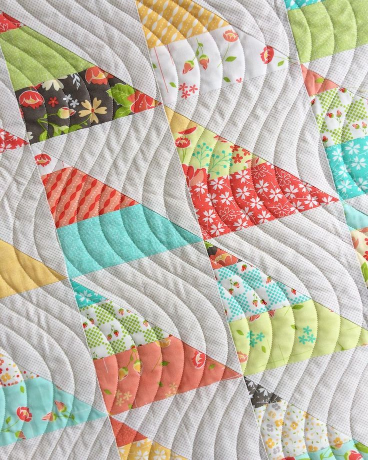Love the wavy line quilting and the patchwork half square triangles