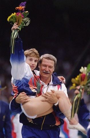Kerri Strug & Bela Karolyi at 1996 Summer Olympics. Photo: Doug Pensinger,  Getty