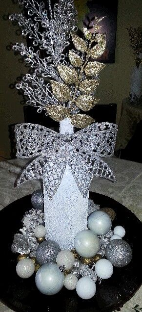 Spray painted wine bottle rolled in Epsom salt, dollar store decorations and fillers.bam Christmas decor